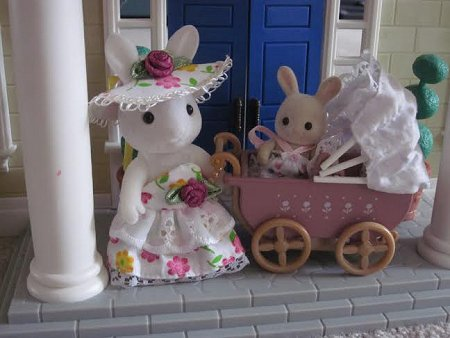 mum rabbit with baby in pram